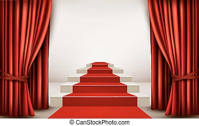 Showroom with red carpet leading to a podium with curtains....