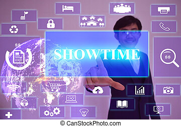 SHOWTIME  concept  presented by  businessman touching on  virtual  screen ,image element furnished by NASA