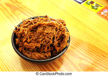 shredded beef in side dish bowl