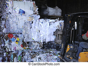 shredded paper packed at a recycling center