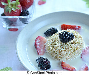 Shredded wheat and berries - Closeup on plate of shredded ...
