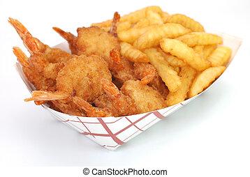 Fried shrimp and french fries basket isolated on white background.