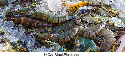 shrimp and other seafood at a market in Thailand