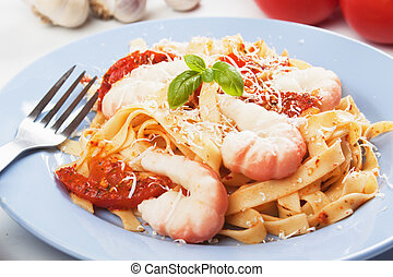 Shrimp and pasta with tomato sauce