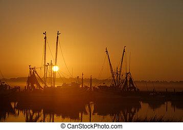 Shrimp Boats at Sunrise - Shrimps boats in the mist at...