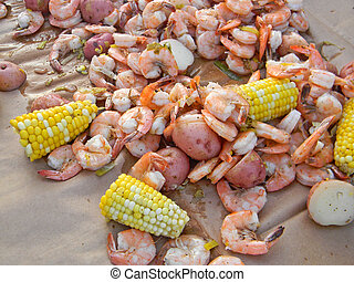 Shrimp Boil - Mix of shrimp, red potatoes and corn on the...