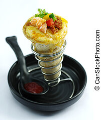 Shrimp cake with chili and herbs on black bowl