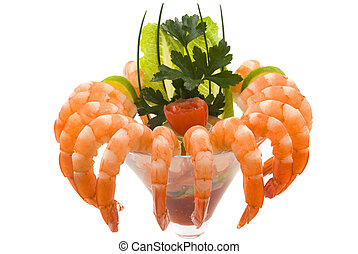 Gourmet large shrimp cocktail with cocktail sauce, lime, lettuce, parsley and chives