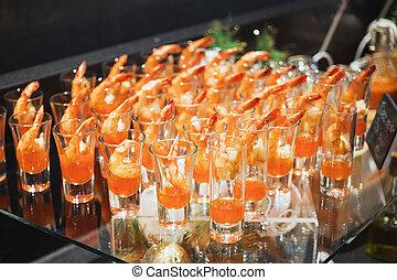 Shrimp cocktail in shot glass shot closeup