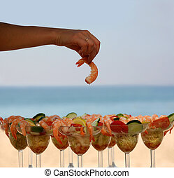 Shrimp cocktail - Woman is having shrimp cocktail on the...