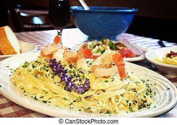 Shrimp Fettuccine - Plate of shrimp fettuccine on table at...