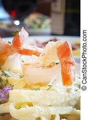 Shrimp Fettuccine - Shrimp atop a plate of Fettuccini ...