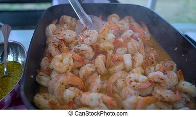 shrimp fried in a pan - the cook is stirring and frying...
