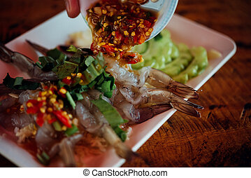 Shrimp in fish sauce at Thai seafood market