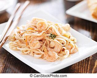 shrimp pad thai shot with selective focus.