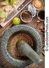 shrimp paste chilli sauce in a mortar stone with Ingredients...