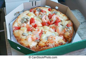 shrimp pizza in the box
