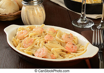 A bowl of shrimp scampi on linguine with parmesan cheese