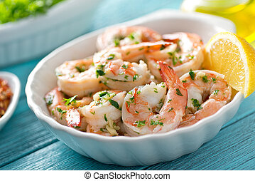A delicious bowl of shrimp scampi with garlic, butter, and parsley.