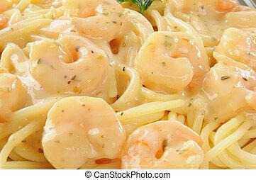 Close up photo of shrimp scampi on spaghetti noodles