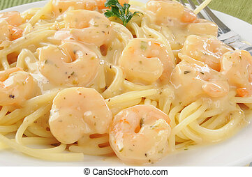 Closeup of shrimp scampi on spaghetti noodles