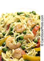 shrimp scampi linguini pasta with garden peas red yellow peppers garlic butter sauce in pan
