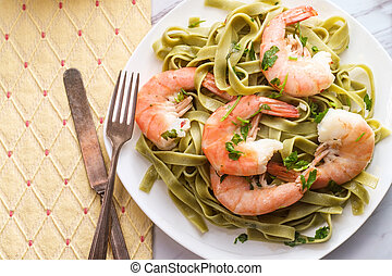 Shell on shrimp scampi with green spinach pappardelle pasta