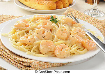 A plate of shrimp scampi with garlic butter sauce