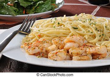 Shrimp scampi with pasta - A plate of shrimp scampi with ...