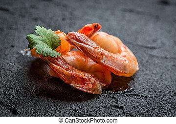 Shrimp served on a stone