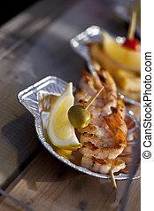 Shrimp skewers and lemon