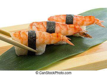 Shrimp sushi nigiri on wooden plate