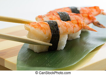 Shrimp sushi nigiri on wooden plate