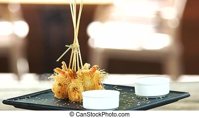 Shrimp tempura, sesame seeds. Tasty seafood appetizer.