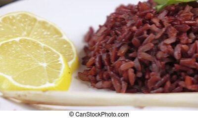 Shrimp with rice on plate - Peeled prawns with black rice
