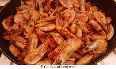 Shrimps fried on a pan - Delicious medium-sized shrimps with...