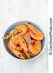 shrimps in blue bowl on white background