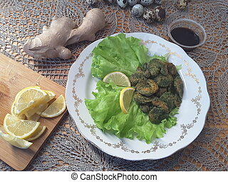 Shrimps in green nettles tempura, on a plate with lettuce,...