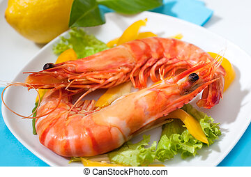 shrimps - king prawns with salad on a plate