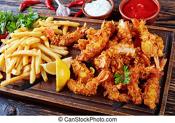 shrimps with french fries and sauces