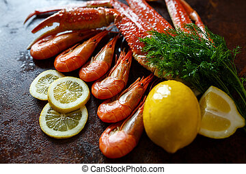 Shrimps with lemon on a background of crab meat