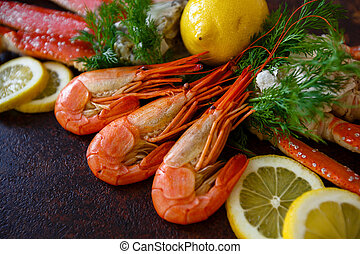 Shrimps with lemon on a background of crab meat closeup