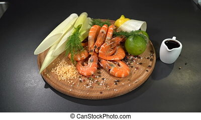 Shrimps with spices and citrus on the cutting board. Dolly...