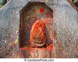 Shrine covered in vermillion to worship Goddess Kali in Dhulikhel, Nepal