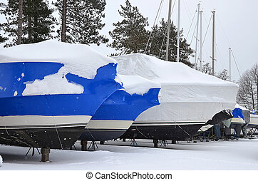 shrink wrapped boats in snow - Blue shrink wrap on boats...