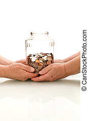 Shrinking value of retirement fund concept with senior hands...