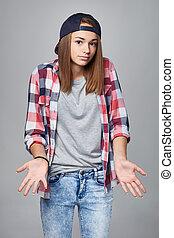 Shrugging teen girl