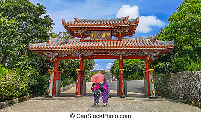 Shureimon Gate in Shuri castle in Okinawa, Japan with blue sky. The wooden tablet that adorns the gate features Chinese characters that mean ?Land of Propriety?