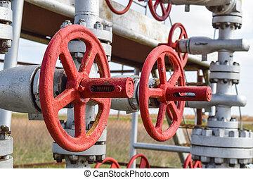 Shut-off valve valve with manual drive. Red steering wheel lock gate valve. oil well equipment