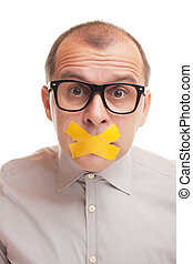 Adult businessman with taped mouth isolated on white background